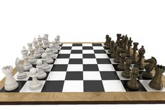 Chess pieces facing off on board Stock Image
