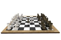 Chess pieces facing off on board Stock Images