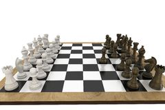 Chess pieces facing off on board Stock Photo