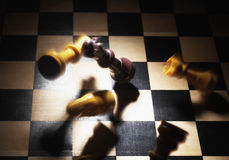 Chess Pieces Falling on Board Royalty Free Stock Image