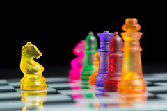 Chess pieces and game board Royalty Free Stock Image