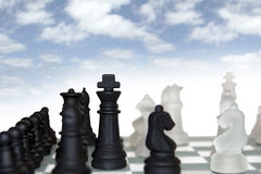 Chess pieces isolated against cloudy sky Royalty Free Stock Images