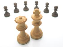 Chess pieces isolated on white. Concept image for surrounded Royalty Free Stock Image