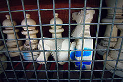 Chess Pieces in Jail Royalty Free Stock Photo