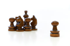 Chess Pieces with a Leader. Chess pieces (pawn, knight, king) with the pawns leadership on white background Stock Images
