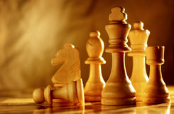 Chess pieces in light wood Royalty Free Stock Image