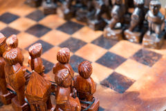 Chess Pieces. Macro shot of a chess pieces and chess board made of wood Stock Photos