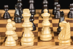 Chess pieces made of wood on a board of the game Stock Photography