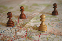 Chess Pieces on Map - Strategic Planning. Chess pawns placed on a map to depict strategic planning or competitive business Royalty Free Stock Photography