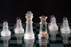 Chess Pieces On A Glass Chessboard Stock Image