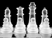 Chess pieces over black Stock Photos