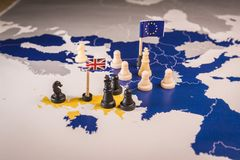 Chess pieces over an european map. Brexit concept. Chess pieces and flags on an European map. Brexit negociations and strategy concept between European Union and stock image