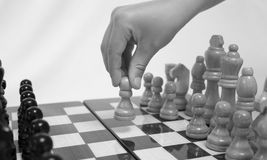 Chess. The chess pieces are placed on the chessboard. Black and white. First step Royalty Free Stock Photography