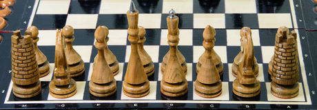 The chess pieces are placed on the chessboard. Royalty Free Stock Image
