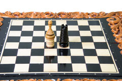 The chess pieces are placed on the chessboard. Stock Images