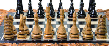 The chess pieces are placed on the chessboard. Stock Photos