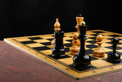 The chess pieces placed on the chessboard. Granite surface. Stock Image
