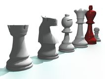 Chess pieces with red king. Row of chess pieces with the king in red color Royalty Free Stock Photo