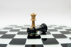 Chess pieces. On a reflecting surface Stock Images