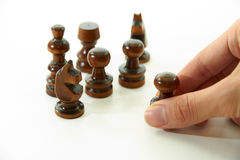 Chess Pieces and Right Hand. Knights and pawn on white background Royalty Free Stock Photo