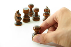 Chess Pieces and Right Hand. Chess pieces are holding by hand on white background Stock Images
