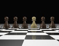 Chess pieces in a row. Togetherness and differentiation idea. Black background Royalty Free Stock Images