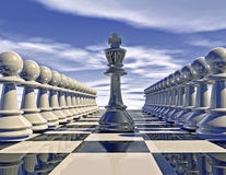 Chess pieces in rows with chess king, war concept idea. Stock Photo
