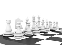 Chess pieces standing on black white chessboard.  Royalty Free Stock Image