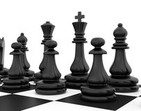 Chess pieces standing on black white chessboard Stock Photo