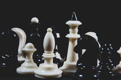 Chess pieces on the table. On black background stock images