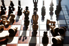 Chess pieces on a table in the park Royalty Free Stock Photo