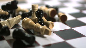 Chess pieces thrown across the board stock footage
