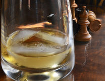 Chess pieces and Whiskey Glass Royalty Free Stock Photo