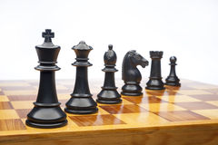 Chess pieces on white Royalty Free Stock Photos