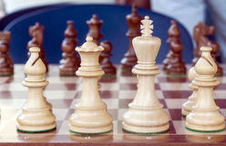 Chess pieces. Chess White pieces in the background are the black pieces Royalty Free Stock Photography