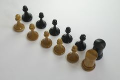 Chess pieces on a white background stock photo