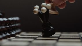 Chess pieces white pawn queen attacks. chess closeup, wooden chess board, slide camera. Studio. slow motion. Business concept, black background stock footage