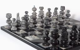 Chess Pieces - White Team at Angle. Onyx stone hand-carved chess set board and pieces Royalty Free Stock Image