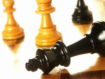 Chess pieces on wood board Stock Photos