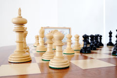 Chess pieces on wood board. Black and white Stock Images