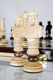 Chess pieces on wood board Stock Images
