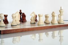 Chess pieces on wood board Royalty Free Stock Photography