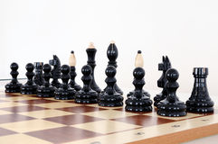 Chess pieces on wood board Royalty Free Stock Images