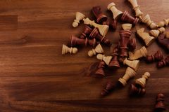Chess pieces on wood. Surface Stock Images
