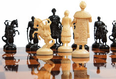 Chess pieces. On a wooden Board Stock Image