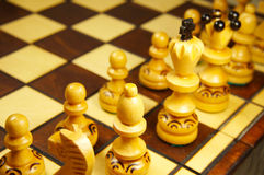 Chess pieces on wooden board Royalty Free Stock Photos