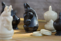 Chess pieces on wooden table, Planing game. chess uniqueness concept on the wooden background Royalty Free Stock Image