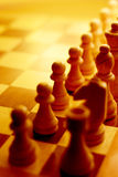 Chess pieces in yellow ambient light Stock Photos