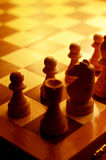 Chess pieces in yellow ambient light Royalty Free Stock Images