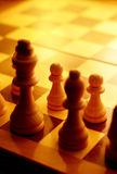 Chess pieces in yellow ambient light Stock Images